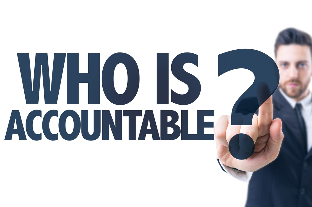 Business man pointing the text Who Is Accountable?.jpeg