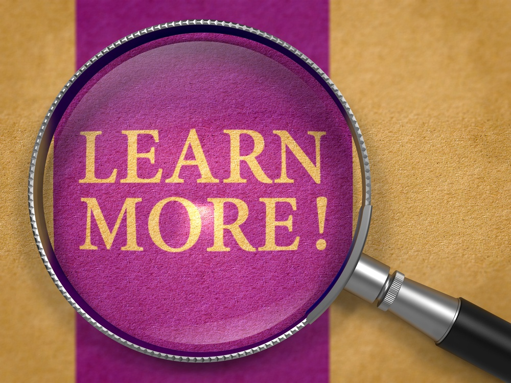 Learn More through Lens on Old Paper with Dark Lilac Vertical Line Background.